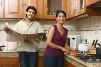 Husband and wife in kitchen - Deepak Budhraja