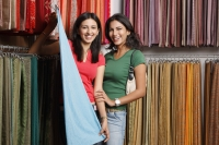 two girls shopping for fabric - Vivek Sharma