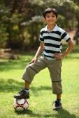 Boy with foot on soccer ball - Deepak Budhraja