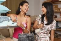 two women shopping for household items - Vivek Sharma