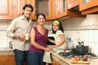Family in kitchen - Deepak Budhraja