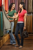 two girls shopping for fabric - Vivek Sharma