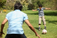 Father and son playing soccer - Deepak Budhraja