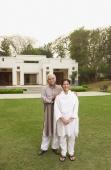 senior couple in front of home - Manoj Adhikari