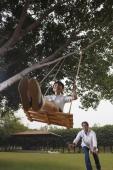 father pushing son in swing - Manoj Adhikari