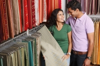 couple shopping for fabric - Vivek Sharma