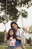 mother with daughter on swing - Manoj Adhikari