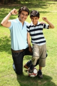 Father and son in park with ball - Deepak Budhraja