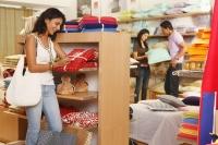 girl in store, couple in background - Vivek Sharma