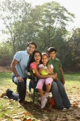 Family of four in park - Deepak Budhraja