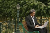 man with laptop on bench - Manoj Adhikari