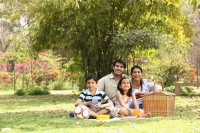 Family in park with picnic - Deepak Budhraja
