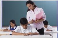 teacher overlooking schoolwork - Alex Mares-Manton