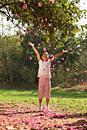 Little girl in park, tossing blossoms in air - Deepak Budhraja
