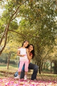 Daughter and mother in park - Deepak Budhraja