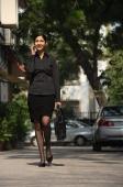 woman on phone walking with briefcase - Alex Mares-Manton