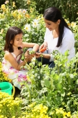 Mother and daughter gardening - Deepak Budhraja