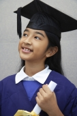 young girl graduate with diploma (close-up) - Nugene Chiang