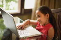 little girl working at laptop (horizontal) - Alex Mares-Manton