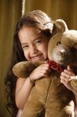 little girl hugging teddy bear - Alex Mares-Manton