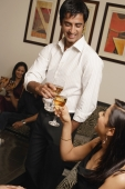 couple at party toasting each other - Alex Mares-Manton