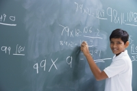 boy at chalkboard, smiling at camera - Alex Mares-Manton