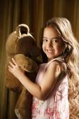 little girl with very long hair holding teddy bear - Alex Mares-Manton