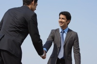two businessmen shake hands (horizontal) - Alex Mares-Manton