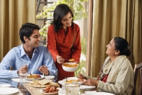 woman serves dinner to man and older woman (horizontal) - Alex Mares-Manton