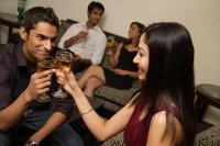 couple toasting each other at party - Alex Mares-Manton