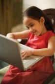 little girl working at laptop (vertical) - Alex Mares-Manton