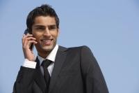 business man on phone, smiling - Alex Mares-Manton