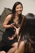 two women talking, drinks in hand (vertical) - Alex Mares-Manton