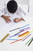 boy works with colored pencils (top view) - Alex Mares-Manton