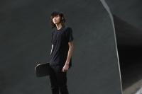 young man holding skateboard - Yukmin