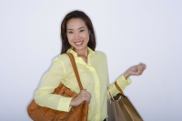 woman with purse and shopping bags - Yukmin