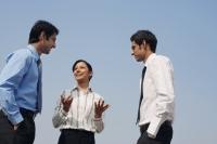 three business colleagues, conversing - Alex Mares-Manton