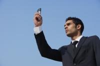 businessman checks his messages (horizontal) - Alex Mares-Manton