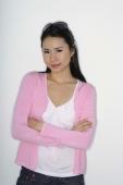woman in pink sweater, arms folded - Yukmin