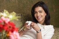 woman smiles holding cup of tea - Alex Mares-Manton