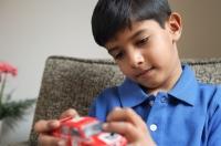 boy holding red car (horizontal) - Alex Mares-Manton