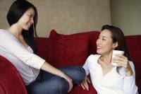 two woman chatting, one on floor - Yukmin
