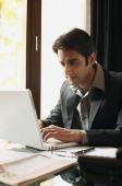 business man working at laptop - Alex Mares-Manton