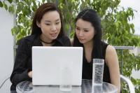 two ladies at lap top computer - Yukmin
