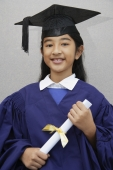 young girl graduate with diploma - Nugene Chiang