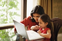 mother and daughter working at laptop (horizontal) - Alex Mares-Manton