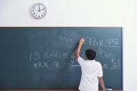 boy at chalkboard (back view) - Alex Mares-Manton