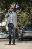 man on phone walking with briefcase - Alex Mares-Manton