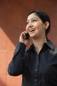 woman in black shirt on mobile phone, laughing - Alex Mares-Manton
