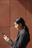 woman reading messages (vertical) - Alex Mares-Manton